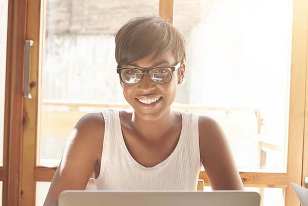 Black Business Woman on Laptop